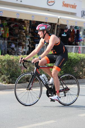 lycra: Editorial: Cyclist Completing Second Stage of Ayia Napa Triathlon, Nisi Beach, Cyprus, Sunday 3rd April 2916
