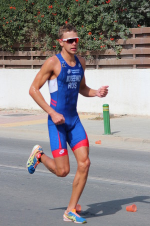lycra: Editorial: Runner Completing Final Stage of Ayia Napa Triathlon, Cyprus, After Doing 750m Swim, 20k Bike Ride and 5k Run in 30 Degree Heat: Sunday 3rd April 2016.