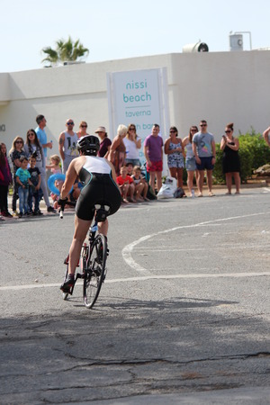lycra: Editorial: Cyclist Completing Second Stage of Ayia Napa Triathlon, Cyprus, After Doing 750m Swim, 20k Bike Ride in 30 Degree Heat: Sunday 3rd April 2016. Editorial
