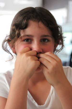 frizz: Young Girl Waiting For Cheese Toastie in Little Cafe in Cyprus.
