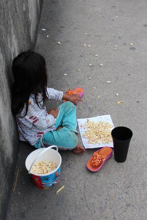 implore: Editorial: Young Girl Begging on Concrete Walkway Over Motorway Interchange, Rangsit, Pathumthani, North Bangkok, 19th October 2013. Editorial