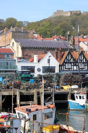 lobster boat: Editorial: Scarborough Town and Harbour Visited by British Holidaymakers on the Hottest Days of the Year; Sunday 8th May 2016.