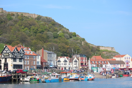 roof profile: Editorial: Scarborough Town and Harbour Visited by British Holidaymakers on the Hottest Days of the Year; Sunday 8th May 2016.