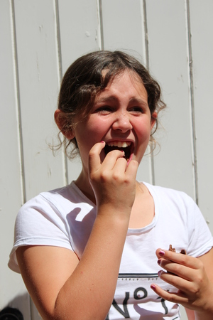 Young girl eating chocolate easter gift in bright sunshine stock young girl eating chocolate easter gift in bright sunshine photo negle Images