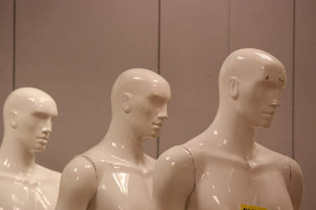 featureless: Male Mannequins Placed In Line.