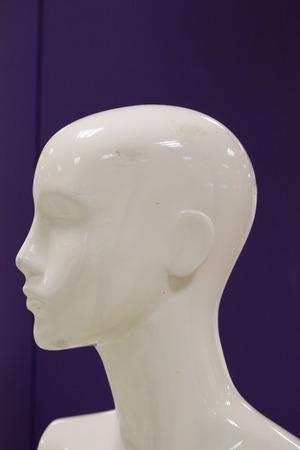 featureless: Female Mannequin Silhouetted Against Purple.