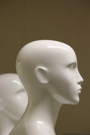 featureless: Female Mannequins in Shades of Ivory and Ochre. Stock Photo