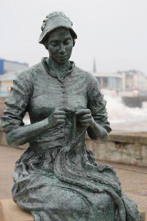 idealistic: Fishergirl Knitting Gansey, Yorkshire, England. Editorial