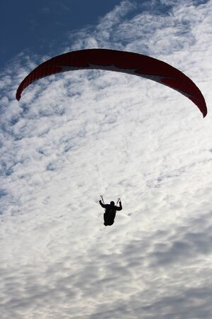 Man Hang Glides on Offshore Air Currents, East Coast of Yorkshire, England. Stock Photo