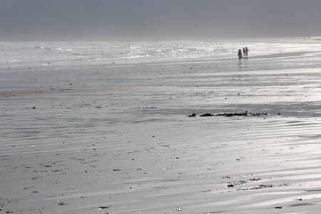 leaden: Spectacular Silver sands on Bleak, Grey, Winters Day, Yorkshire, England.