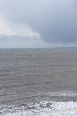 leaden splash: Turbulent, Stormy Day at Yorkshire Coast in April.