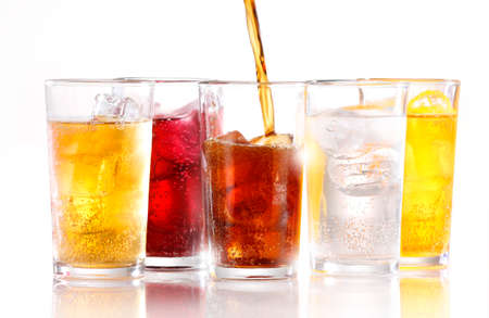 soft drinks: Soft drinks with ice being poured