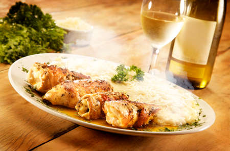 plateful: A plateful of grilled chicken thighs, white sauce with salad and white wine