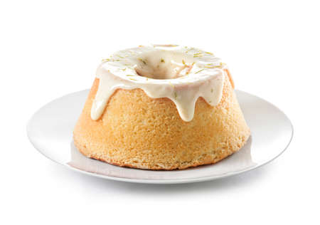 calorific: A lemon sponge cake with icing and lime rind Stock Photo