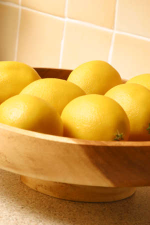 fruit bowl: Lemons in a fruit bowl in a kitchen Stock Photo