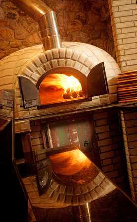 pizza oven: A lit stone baked pizza oven