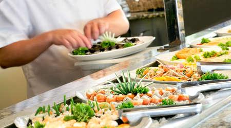 SUSHI: A shallow depth of field image looking along a sushi buffet bar