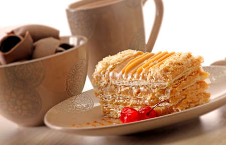 flaky: A shot of a flaky caramel slice and a cup of tea  coffee Stock Photo