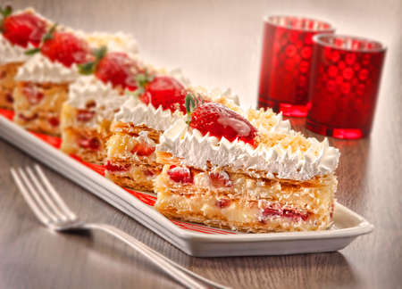 calorific: Slices of strawberry flan with flaky pastry Stock Photo