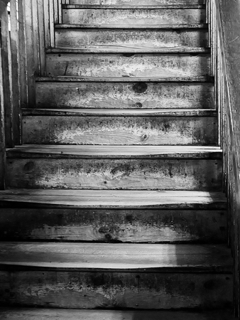 Old worn wooden staircase in monochroome