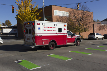 ave: Baltimore, MD, USA - November 18, 2016: Baltimore City Fire Department ambulance on a call on Greenmount Ave.