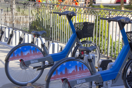 md: Baltimore, MD, USA - November 4, 2016: Baltimore Bike Share bikes in rack near City Hall in War Memorial Plaza.