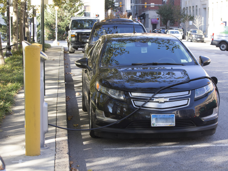 md: Baltimore, MD, USA - November 4, 2016: Hybrid electric car recharges at a station near City Hall.