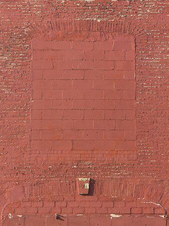 keystone: Brick building wall openings closed up