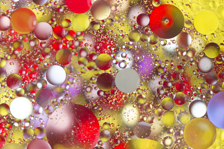 Colorful bubbles in backlit oily water