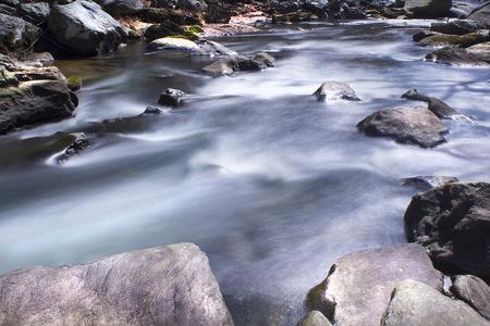 downstream: Deer Creek Rapids long exposure, water and rocks downstream view
