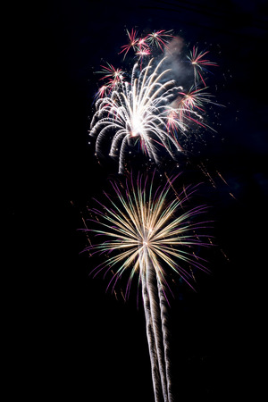 Holiday fireworks display featuring colorful bursting shells. Stock Photo