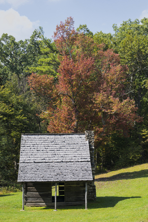 Front view of the Preacher Jesse Brown's historic cabin located in E. B. Jeffress Park along the Blue Ridge Parkway in Ashe County, North Carolina.
