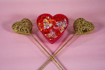 Glowing red heart with gold filigree hearts. 版權商用圖片