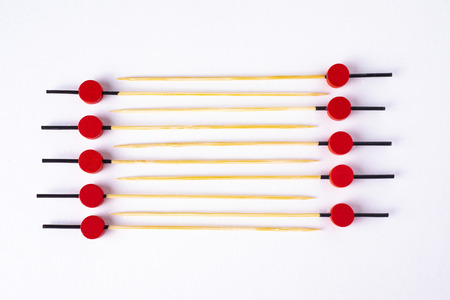 Ladder of colorful food skewers on white background. 版權商用圖片