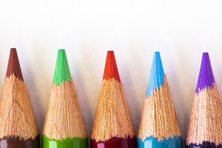 Closeup view of five sharpened color pencils.
