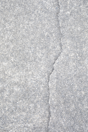 Light gray aggregate material with crack. Background material;
