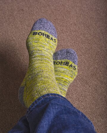 Yellow Bombas calf socks shown worn with blue jeans.
