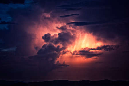 Cloud to cloud lightning illuminates a North Carolina thunderstorm over the Blue Ridge. 版權商用圖片 - 153840050