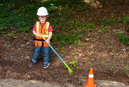 Young boy dressed for his role as a construction worker. 版權商用圖片