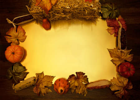 Flat lay frame formed by fall harvest items with gold center.
