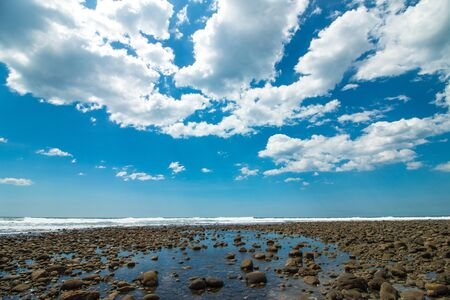 sky and clouds: Wide angle view of the volcanic beach at Playa El Tunco at El Salvador