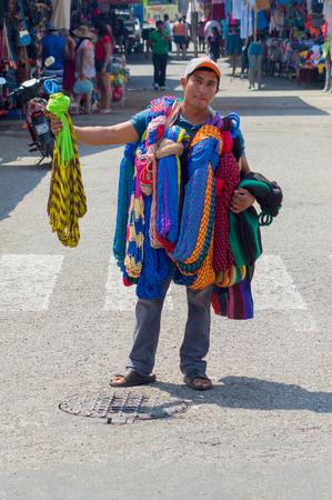 retailer: Hammock vendor in a street amrket in Huatulco, M?xico Editorial