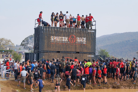 Crossfit athletes climbing an extreme obstacle in a Spartan  Race  at Mexico Stok Fotoğraf - 37798359