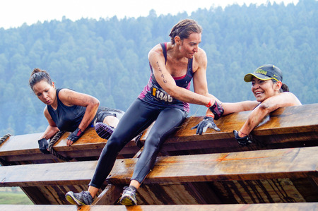 sports race: The Spartan Race is an extreme military style obstacles race where athletes run on hits of 300 participants, resembling the 300 spartan soldiers that fought under command of the legendary greek general Leonidas on the Thermopylae Battle. These female athl Editorial