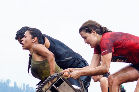 mud woman: The Spartan Race is an extreme military style obstacles race where athletes run on hits of 300 participants, resembling the 300 spartan soldiers that fought under command of the legendary greek general Leonidas on the Thermopylae Battle. These female athl Editorial