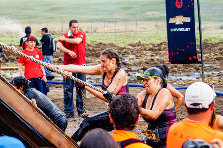 Spartan Race Sprint. Athletes crossing a muddy water pond.The Spartan Race is an extreme military style obstacles race where athletes run on hits of 300 participants, resembling the 300 spartans soldiers that fought under command of the legendary greek ge Sajtókép
