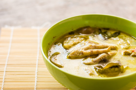 Thai chicken green curry in bowl Stock Photo