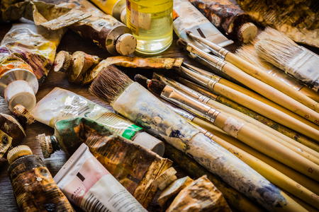 oil paints: Paintbrushes and oil paints on wooden table