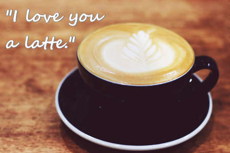 Quote with Cafe Latte on wood background.