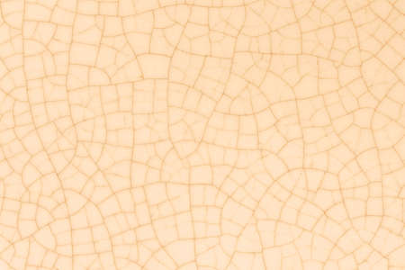 Yellow beige crack ceramic tile. Pale brown color of glazed tile texture abstract background. Texture of crackle glass mosaic tile. Banque d'images